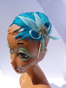 Bespoke Hats with blue feathers and blue jewels.