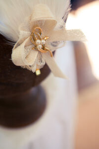 Bespoke hat with a cream bow.