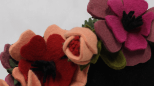 Felt flower hair piece available in the online shop.