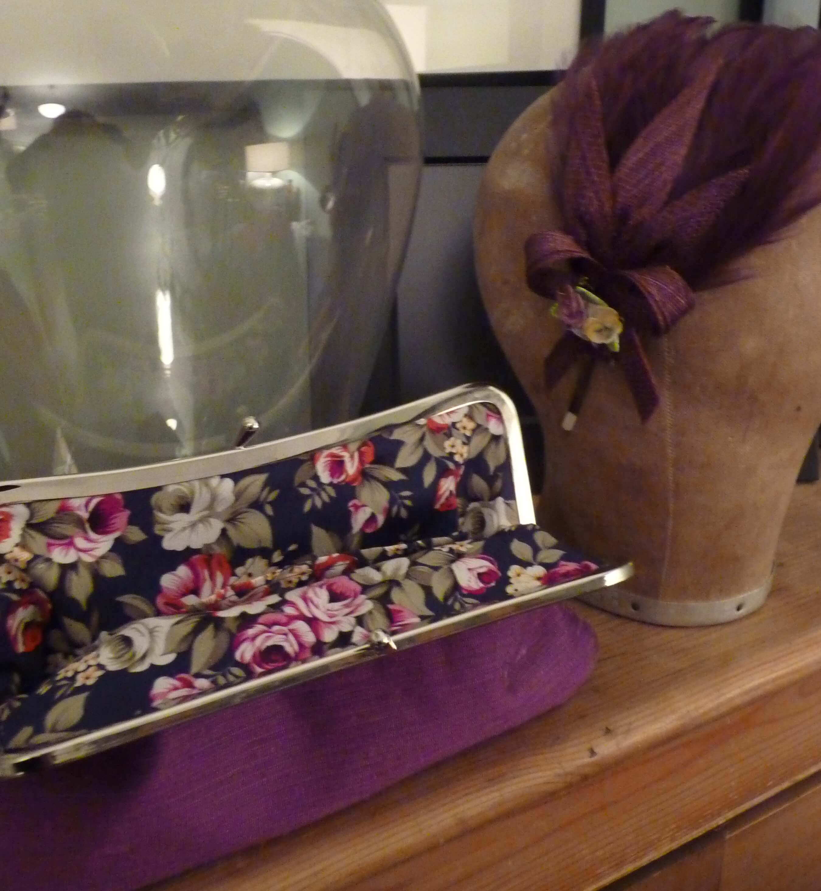 Clutch bag and matching feather head piece.