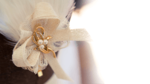 Cream bow hat with gold and pearls.