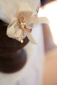 White bespoke hat made with feathers and sinamay.