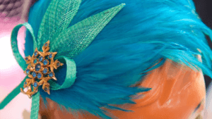 Blue bespoke hat with feathers.