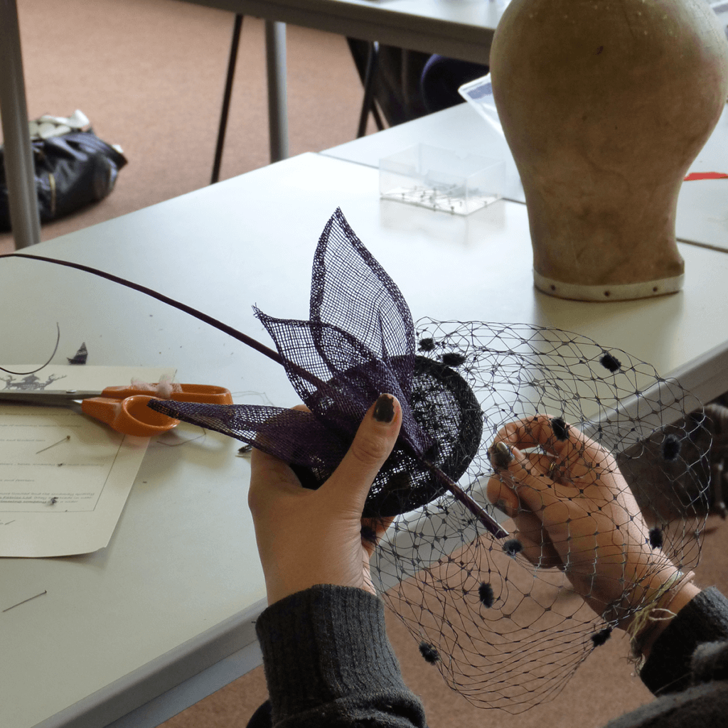 Working on fascinators at a millinery classes and workshops.