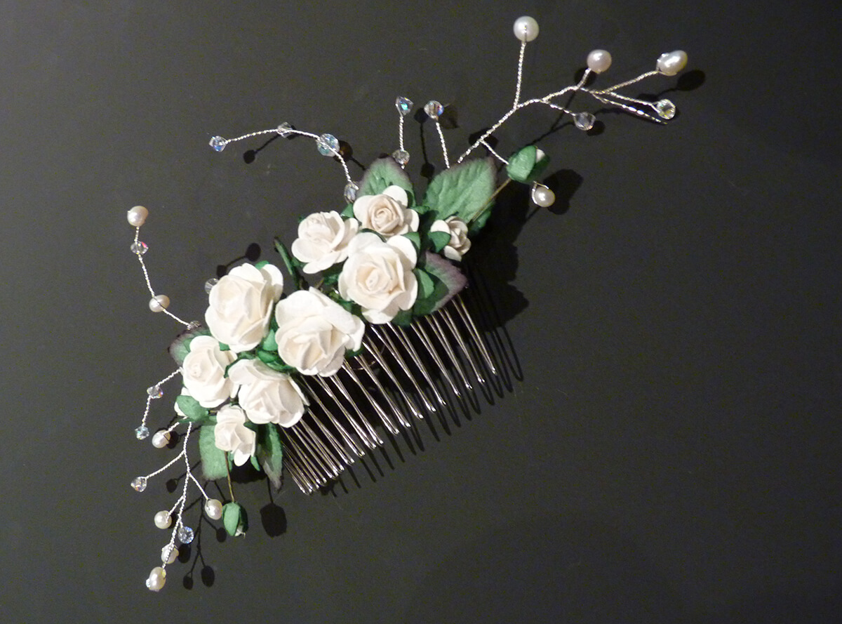 Flower comb with beads.