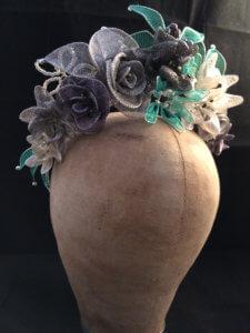 Green and grey flower bespoke hat head piece.