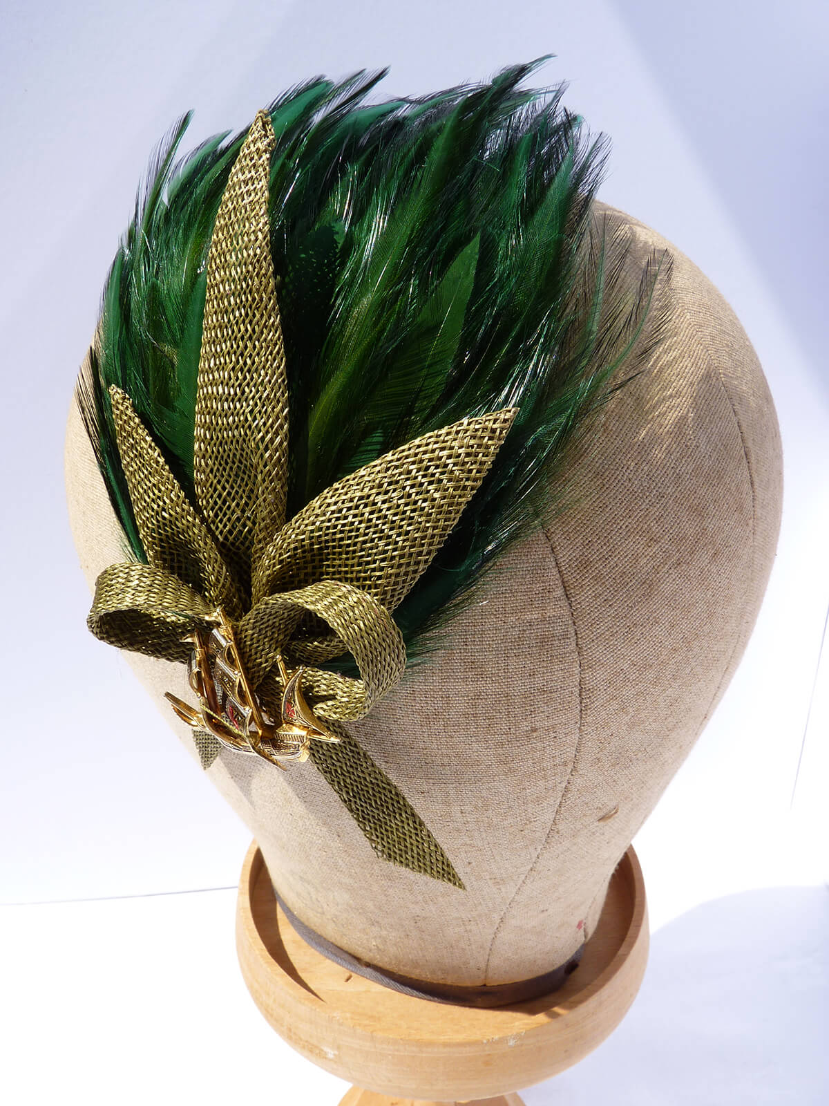 Green feather bespoke hat with green detail.
