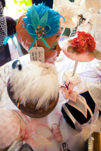 Various bespoke hats and headpieces in the shop.