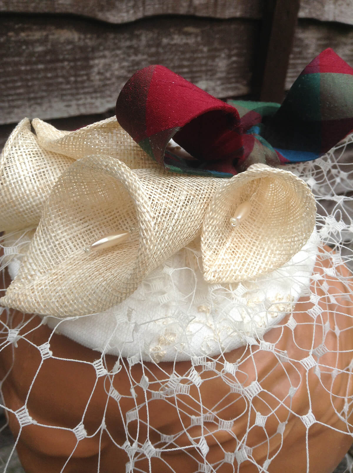 Sinamay bespoke hat with ribbon.
