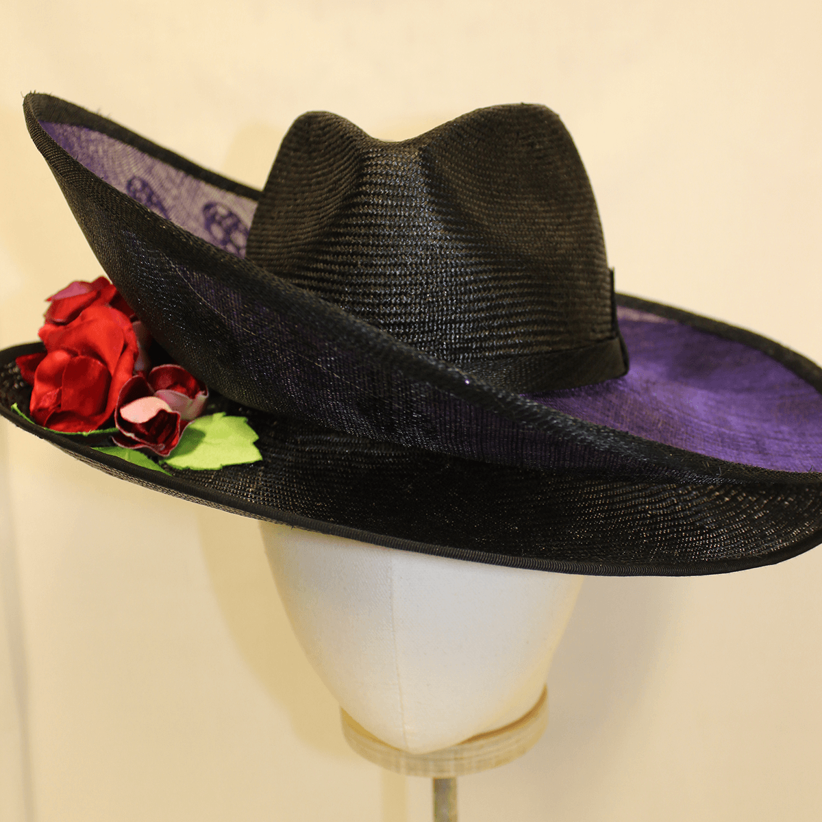 Black and purple wide brimmed hat.