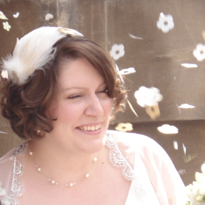 Daisy wearing one of Alison's bespoke hats for her wedding.